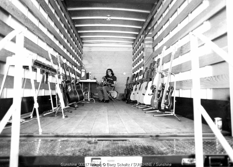 Glenn Frey of the Eagles made at a concert backstage tuning guitars in 1975