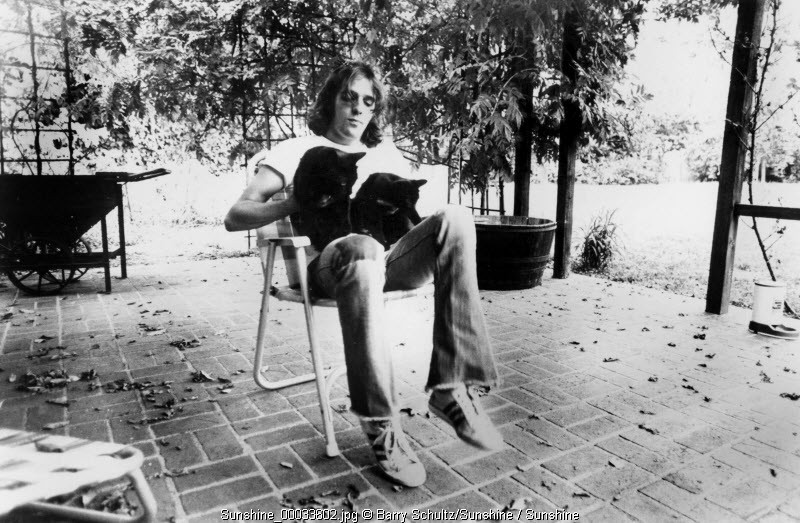 Glenn Frey of the Eagles made at his home in Los Angeles in 1975 with his two cats RIP January 2016